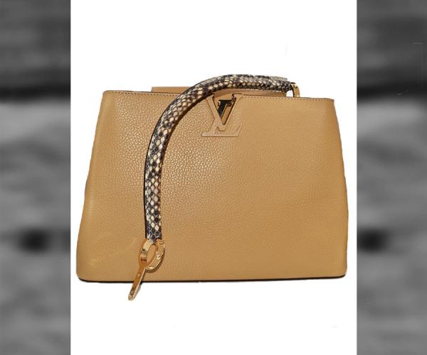 Riparazione tracolla Louis Vuitton